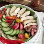 Grilled chicken salad with vegetables in a bowl