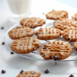 These crispy Six Ingredient Peanut Butter Chocolate Chip Cookies are so easy a 10 year old can make them. low carb, gluten-free, dairy-free, keto, thm | lowcarbmaven.com