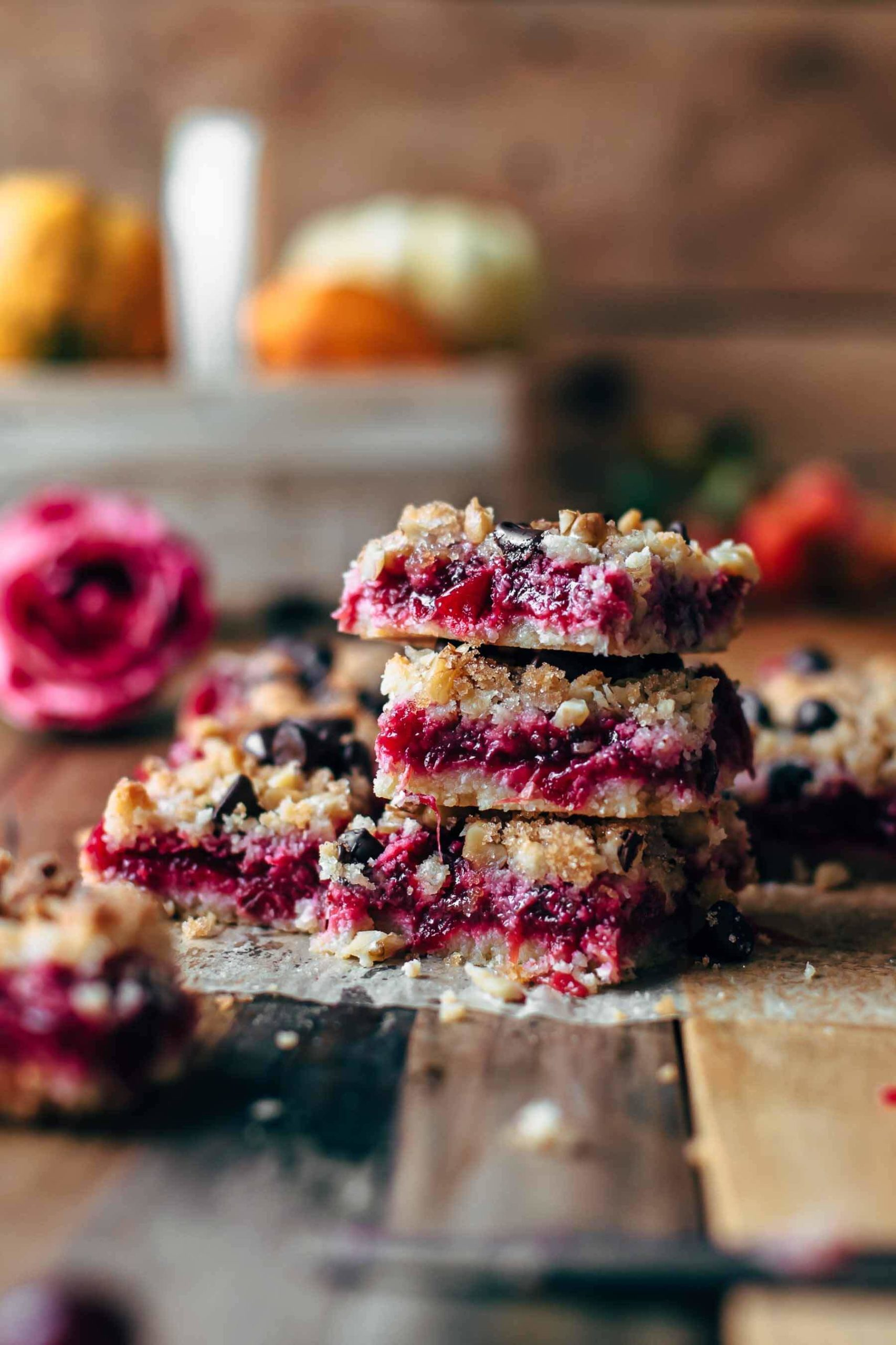 Sliced cranberry crumb bars with walnuts and chocolate chips stacked