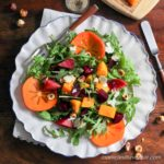Harvest Salad with persimmon, beets, butternut squash, hazelnuts and arugula.