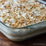 Peanut flour crust, silky cream cheese, rich peanut butter pudding, whipped cream. Made from scratch with wholesome ingredients! | low carb, gluten-free, keto, thm