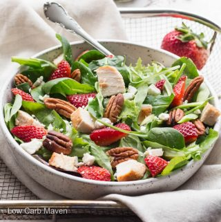 Spinach strawberry pecan salad with feta cheese and homemade balsamic vinaigrette.