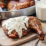 Alabama white BBQ sauce with smoked chicken quarters.