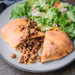 Homemade Sloppy Joe Hot Pockets! for keto diets on a plate served with salad.