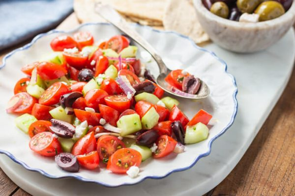 Mediterranean Cucumber Salad with tomatoes, red onion, kalamata olives, and feta cheese.