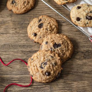 Keto chocolate chip cookies on a table with red twine.