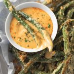 Oven fried Parmesan green beans with sweet mustard dipping sauce.
