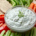 Greek tzatziki cucumber yogurt sauce with cut veggies.