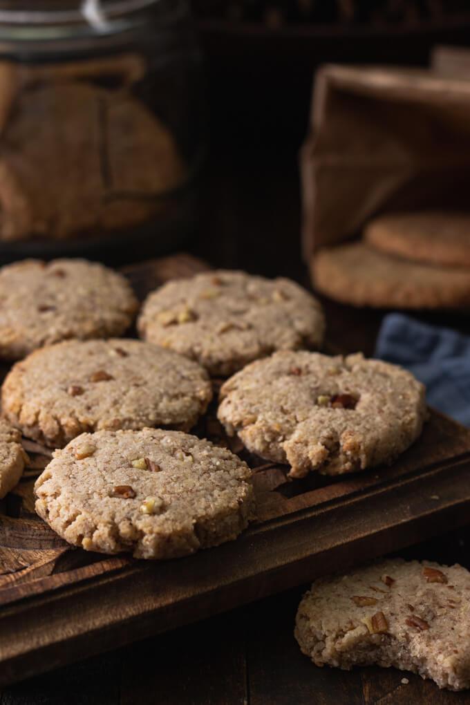 pecan sandies cookies on a trivet with more cookies in the background
